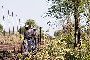 Village police near the fence on patrol