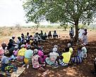 Mangalane meeting under a tree